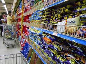 Snack aisle at a larger grocery store, nothing but individual portions of chips.